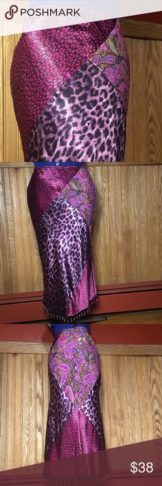 """Unique leopard paisley print tasseled skirt S/M Great vintage condition.  100% Polyester  Waist 28"""", stretches up to 32"""" Elastic waistband  Really cute tassels around around hemline.  Made in USA  1st and 2nd photo depicts front of the skirt, 3rd photo is the side of the skirt, #4 is the back of the skirt. Any questions just ask :) Uncivilized Skirts Midi"""