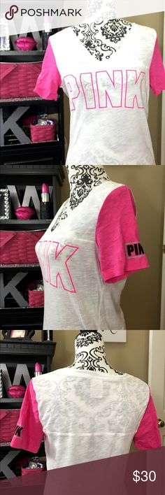 VICTORIA's SECRET PINK TEE SIZE MEDIUM HOT PINK Victoria's Secret Pink tee in great condition.  Short sleeve in a size medium.  White with hot pink!  Worn once and washed and put away.  Needs a new home. PINK Victoria's Secret Tops Tees - Short Sleeve