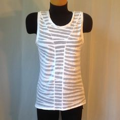 White Converse top See through stripes. Loose fitting. There is writing with sharpie on the inside tag. Converse Tops