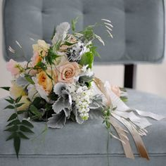 this is a beautiful bouquet with wintery hues of soft grey, peach and bronze. it would be lovely for a wedding but also for a table arrangement.