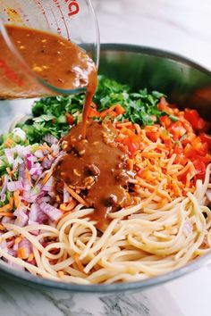 This crunchy Thai noodle salad is smothered in my favorite sesame peanut sauce. Its easy to make and absolutely addicting to eat! You can serve these noodles cold or hot and add even more sriracha for a kick! Asian Pasta Salads, Thai Pasta, Thai Noodle Salad, Thai Noodles, Asian Noodles, Pasta Salad Recipes, Sauce Recipes, Crunchy Noodle Salad, Noodle Salads