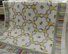 Grandmother's Diamond Ring by Mary and Quilted by LizzyJo Quilts. Pattern from The Creative Pattern Book by Judy Martin.
