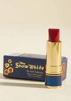 Besame Cosmetics Storybook Smile Lipstick in Snow White Red - Yours is forever the land's loveliest face, and even moreso with this Besame Cosmetics lipstick accenting your lips! Refined to match the original pout hue of the iconic Disney classic Snow White, this magical cosmetic comes tucked inside a gloriously gilded tube, just waiting to add character to your charming expressions.