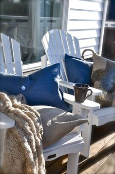 Navy pillows w/burlap contrast pillows on white Adirondack chairs. Coastal Cottage, Coastal Homes, Coastal Style, Coastal Living, Coastal Decor, Seaside Style, Cottages By The Sea, Beach Cottages, Adirondack Chairs