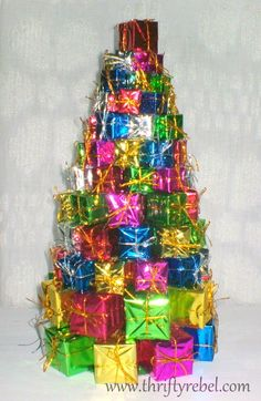 My grandma has had a tree like this for years, it's pretty much tradition to have one of these in my house. So easy to make too, simply get wrapping paper, foiled string, and Styrofoam that you can cut and mold yourself. :)