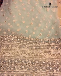 A little blue hues in pastels in this classy saree with heavy borders in white lace and tiny pearls.