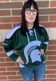 Take your Spartans support to the ice in this Michigan State Spartans Green Mens Plow Hockey Jersey! Rally House has a great selection of new and exclusive Michigan State Spartans t-shirts, hats, gifts and apparel, in-store and online. Michigan State Spartans, Branded Shirts, Graphic Sweatshirt, Hockey, Sweatshirts, Industrial Lamps, Rally, Green, Texas