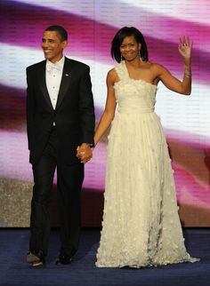 2009: Michelle Obama | Widely regarded as one of the most successful Inaugural Ball gowns in history due to its strong attachment to Barack Obama's platform of hope, Michelle Obama chose Jason Wu for her husband's first inauguration. (Photo by STAN HONDA/AFP/Getty Images)  via @AOL_Lifestyle Read more: https://www.aol.com/article/lifestyle/2017/01/18/first-ladies-inauguration-ball-gowns-50-years/21657651/?a_dgi=aolshare_pinterest#fullscreen