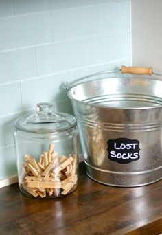 Laundry Room Ideas, This lost socks bucket is so cute, and easy to make with chalkboard stickers! ~via The Hatched Home.