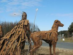 Cuchulain and hounds statue. Located on a roundabout at Ballymany, Newbridge in County Kildare and close to the Curragh Racecourse. Steel Sculpture, Lion Sculpture, Glen Of Imaal Terrier, Irish Terrier, Irish Celtic, Dog Art, Doge, Dog Breeds, Irish Wolfhounds