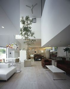 """""""I want a 9 car garage and be able to enjoy viewing one of them in the living room."""" Takuya Tsuchida designed exactly such a house, it has an elevator for one car from the garage to the living room."""