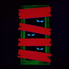 Homemade haunted house decorations... DIY: old frame, black foam board, neon duck tape, and black light.