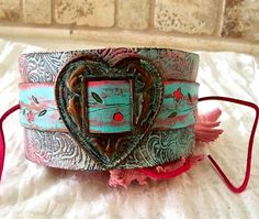 Leather wrist cuff , upcycled belt , vintage buckle , distressed cuff, hand painted leather, floral details, bohemian cuff , heart cuff. on Etsy, $35.00