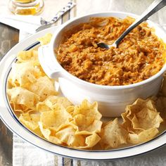 My husband, Jamie, and I love to entertain and this hearty, 7-ingredient dip is always a hit…as well as a request. It couldn't be much easier to put together, and using our slow cooker leaves us free to share some quality time with our guests. After all, isn't that the purpose of a holiday party? —Heather Courtney, Ames, Iowa Slow Cooker Appetizers, Appetizer Dips, Appetizers For Party, Slow Cooker Recipes, Appetizer Recipes, Cooking Recipes, Crockpot Recipes, Crowd Appetizers, Cooking Ideas