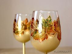 Wine Glasses, Retirement Gift, Wedding Glasses, Hand Painted Glasses, Autumn Leaves, Maple Leaves Rustic wedding glasses  Custom order 5-7 days!  A set of two wine glasses decorated with maple leaves in warm, autumn colors such as gold, brown, orange, yellow, green and copper. The stems of the glasses are in king gold color. The leaves are transparent and looked on direct sunlight the colors seem to glow beautifully. Each of them can be personalized on the base with your names or wedding…