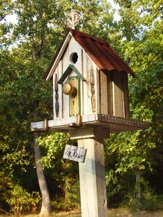 Birdhouse made with old tin, reclaimed wood, old door knob, piano peddles & other neat stuff.