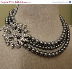 Mother of the Bride Pearl Necklace Set  3 strands of grey glass pearls rhinestone brooch is adjustable size wedding jewelry set gift. $80.10, via Etsy.