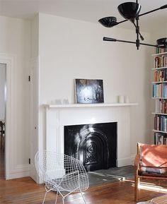 Walls: Benjamin Moore Soft Chamois (flat) Ceiling/moldings: Benjamin Moore Simply White (flat/satin) Doors: Benjamin Moore Onyx (satin)