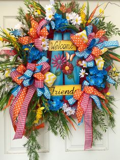 Colorful Spring and Summer Mesh Wreath  by WilliamsFloral on Etsy https://www.etsy.com/listing/235582015/colorful-spring-and-summer-mesh-wreath