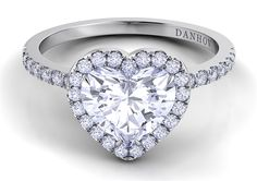 Inspired by Lady Gaga's heart-shaped diamond engagement ring, we present you with Danhov's heart-shaped white diamond ring, set in platinum and featuring a gorgeous center stone, halo, and diamond-studded shank. www.diamonds.pro