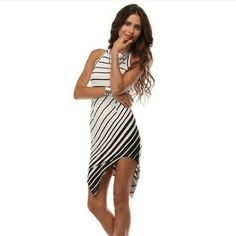 NWT Beautiful Asymmetrical Black & White Dress Simply beautiful. Material is 96 percent polyester and 4 percent spandex. Across the chest is 12.5 inches and waist is 12.5 inches and length is 40 inches. Price is firm Dresses Asymmetrical