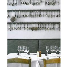 This wall design with old utensils is from a restaurant, but you could use in your home's kitchen.