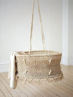 Gorgeous hanging bassinet by purebaby.dk.