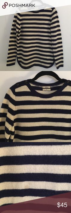 Madewell 100% Wool Striped Sailor Sweater 100% merino wool sweater in classic navy and cream stripe. Long sleeves. Rinsed hem. Nautical button detail at the shoulder. Crew neckline. One stain on the front see third photo. Minor pilling but no moth holes. So cozy and classic! Madewell Sweaters Crew & Scoop Necks