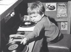 Gee, even when he was a small boy, Jim Morrison was spinning records. He's so cute.