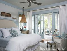 This bedroom opens up to a second-floor screened porch. Lovely! - Photo: Jean Allsopp / Design: Georgia Carlee
