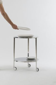 Tambour collection  2011 Side table collection  Die cast aluminium Single tray table: Ø 550 x 360 mm Double tray table: Ø 550 x 470 mm Double tray high table: Ø 550 x 650 mm Double tray high table with wheels: Ø 550 x 650 mm