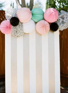 Card board, wrapping paper, & lanterns for a party backdrop! Maybe even for back of photobooth!