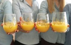 Personalized with lovely hand lettering in the color of your choice, these stemless wine glasses make perfect bridesmaid gifts.