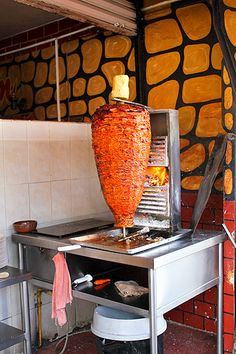 Tacos de trompo (aka tacos al pastor), my favorite tacos in the world. Thinly sliced marinated pork is skewered and roasted on a vertical rotisserie, then sliced thinly into tacos.