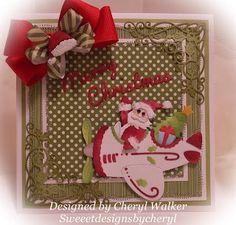 by Cerhyl Walker: Sweeet Designs By Cheryl CottageCutz Dies: Flying Kris Kringle, Merry Christmas: Homemade Christmas Set, Elegant Holly Corner. Really Reasonable Ribbon: Red Grosgrain , Satin Diagonal stripe green. Copics: R59.R39,R37; G24, E93 cheeks, R00 face ,W-3. W-5 hair shadow. Buttons,Sewing. American Crafts dsp. Hat/cuffs: white mflower soft