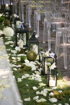Aisle decor of moss and lanterns- LOVE!! // photo by  Rebecca Bouck Photography, planning by Weddings by Socialites, see more: http://theeverylastdetail.com/romantic-pink-green-garden-wedding/
