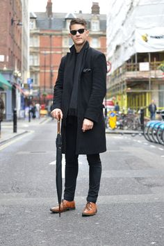 Wearing a black tailored coat with a black scarf and black skinny jeans with brown brogue shoes #aw14 #fashion #style #inspiration #mens
