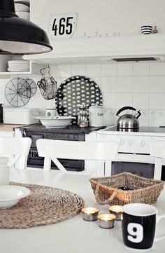 Black and white base colors. Wow a pop of yellow, coral, kiwi would be awesome in this kitchen.