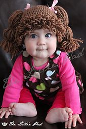 Ravelry: Cabbage Patch Kid Inspired Hat pattern by Amanda Lillie.  I cannot WAIT to make this!!!