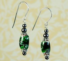 Mount St. Helen's Volcanic Ash beads handmade by Jim Clarke are the focal point for these attractive looking earrings, the...