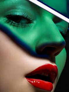 Red and green are complementing each other. Red especially pops with its gloss and light and with green shrouded