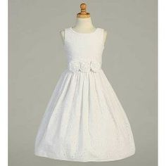 A very simple yet elegant dress for your little girls First Communion from Lito.  This embroidered cotton tea length dress has flower accent...