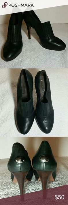 BCBG Maxazria Bootie Heels These are a gorgeous pair of BCBG Maxazria Black Bootie Heels. The shoe and soles are 100% leather aside from the elastic front. The body of the heels are in amazing condition. The soles have wear but still have a long life left in them. The insoles are in good condition the only thing is the leather inside tip of the toe rolls back a little when you take them off. But you just push it back down and it isnt noticeable when wearing. very very comfortable shoes…