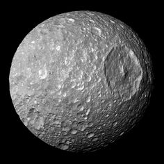 Saturn's moon 'Mimas', as imaged by the Cassini spacecraft. It was discovered on 17 September 1789 by English astronomer William Herschel, and was named after Mimas, a son of Gaia in Greek mythology, by Herschel's son John. The large Herschel Crater is the dominating feature of the moon. With a diameter of 396 km (246 mi), it is the smallest astronomical body that is known to be rounded due to self-gravitation. Photo: NASA/JPL/SSI