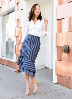 Sydne Style styles what to wear to work for spring in white button down and stripe skirt #stripe #skirts #prints #workoutfit #louboutin