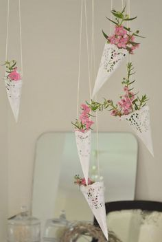 Paper doilie hanging baskets ~ I could see these hanging from the backs of chairs at a ladies/girls tea and the guests get to take home an herb used in the process of making tea or a cutesy flower to grow. Inexpensive and adorable. Paper Doily Crafts, Doilies Crafts, Paper Doilies, Party Decoration, Wedding Decorations, Bridal Shower, Baby Shower, Hanging Baskets, Party Planning
