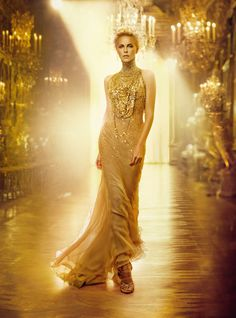 Charlize Theron in Dior photographed by Patrick Demarchelier in the Galerie des Glaces at the château de Versailles.