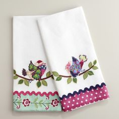 Our Waffle Weave Appliqué Bird Kitchen Towels are go-to essentials for cleaning up after a night of entertaining. They're lightweight and highly absorbent. Each quick-drying towel's textured surface is crafted in India of 100% cotton with stylish appliqué borders and festive ric rack trim. The finely embroidered birds on leafy branches display a charming holiday appeal.