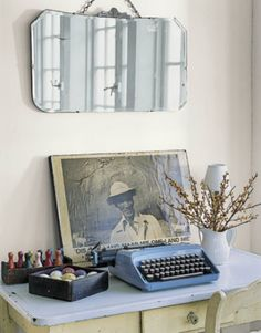 blue Typewriter, white table, mirror