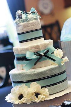 Fun diaper cake idea for a baby shower! Via Kara's Party Ideas @HUGGIES Baby Shower Planner Baby Shower Planner